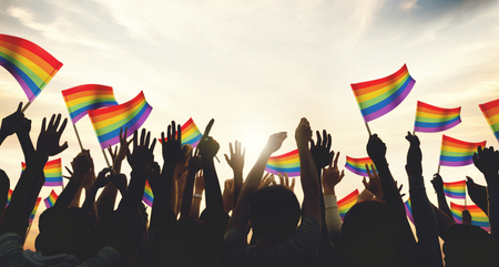 A crowd with LGBT rainbow flags 免版税图像