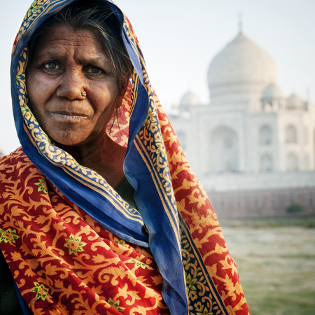 Indigenous Indian woman and The Taj Mahal as a background.