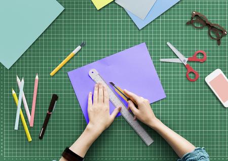Woman Cutting Paper Stationery Workstation Concept Reklamní fotografie - 90814974
