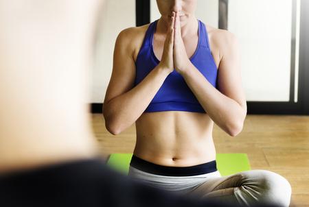 Woman doing Anjali mudra yoga pose