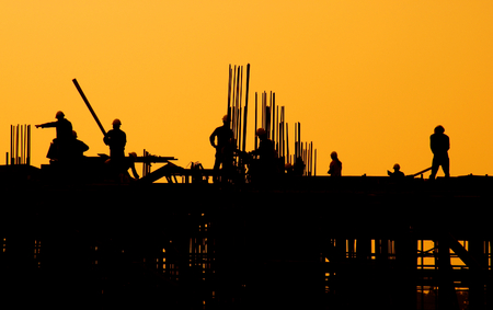 Construction workers at sunset. Stok Fotoğraf