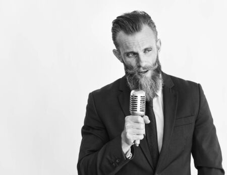 Business man talking on microphone grayscale