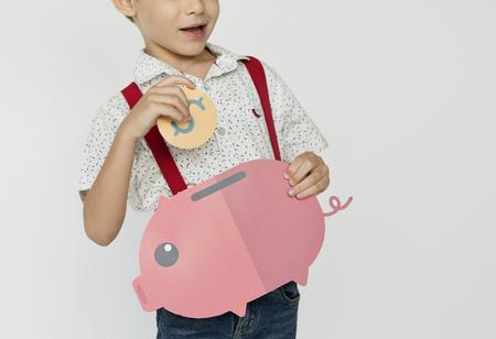 Kid Holding Piggybank Saving Money