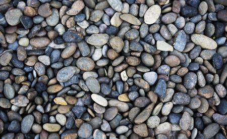 Pebble rocks texture pattern wallpaper Standard-Bild