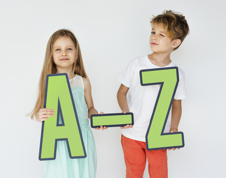 Kids holding letters of the alphabet