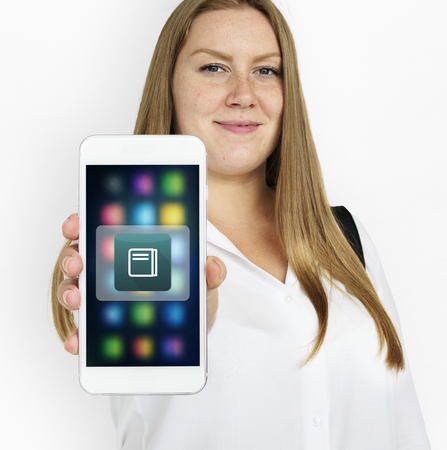Portrait of a longhaired woman holding a phone Stock Photo