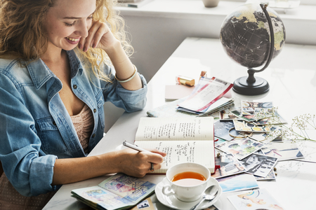 Woman Writing Diary Travel Journey Photos Concept