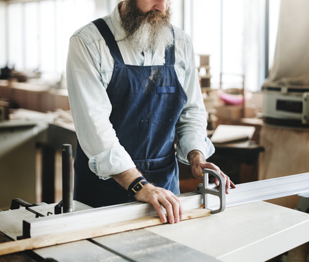 Craftsman working in a wood shop Stock Photo