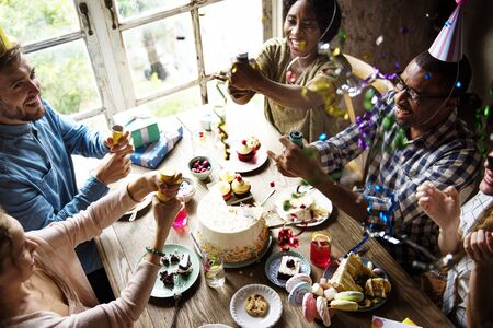 People Using Party Popper at a Birthday Celebration Stock Photo