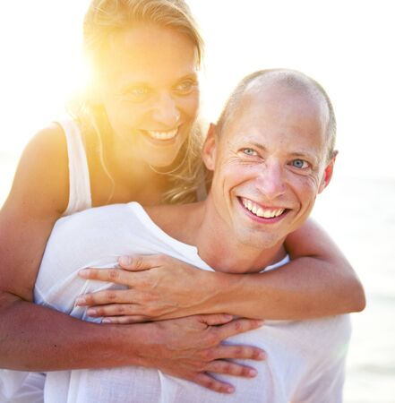 A Caucasian couple is dating at the beach Stock Photo