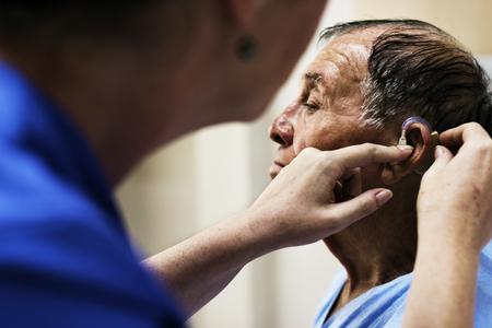 An old man wearing hearing aids 版權商用圖片