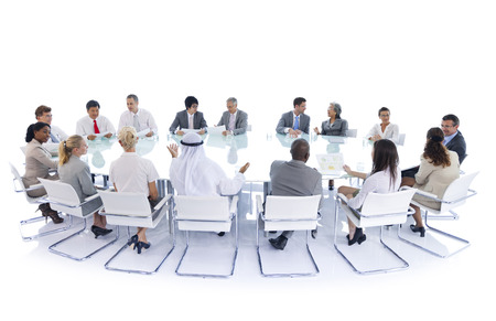 Business people in a board room meeting
