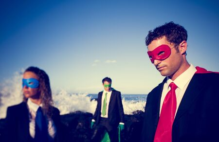 Business superheroes on the beach. Stock Photo