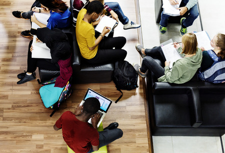 Students studying in a library environment