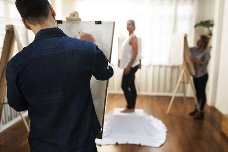 Artists drawing a female portrait Reklamní fotografie