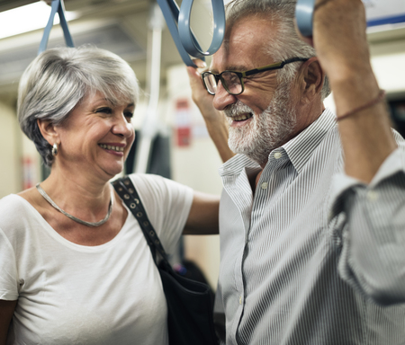Senior couple traveling inside train subway Фото со стока
