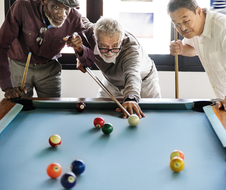 Senior friends playing pool