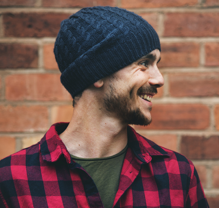 Man Beanie Hat Hipster Style Brick Wall Smiling Concept Stock Photo