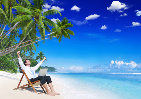 Businessman working on a tropical island