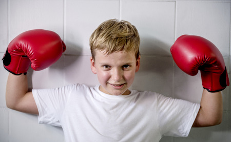 Young boy aspiring to become a boxer