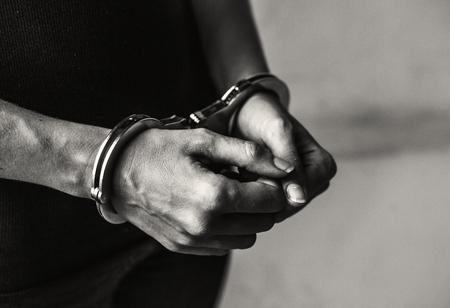 Criminal in handcuffs Stock Photo