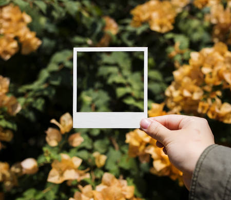Hand holding an empty picture frame Stock Photo