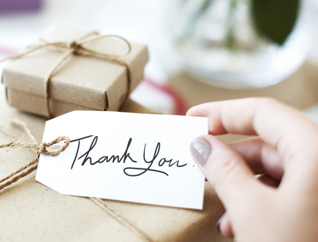 Gift box with thank you card Stock Photo