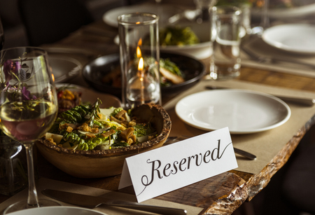 Reserved table at a restaurant Imagens