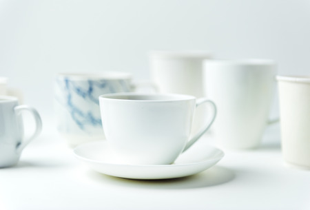 Closeup of coffee cups on white table