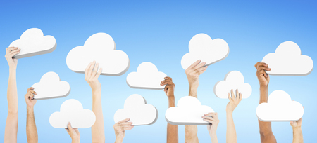 People holding clouds Stock Photo
