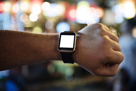 Arm with digital wrist watch at night time Stock Photo