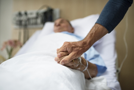 Holding hands in a hospital Stockfoto