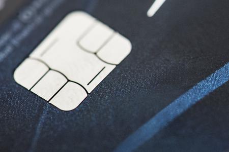 Closeup of EMV credit card chip macro Фото со стока
