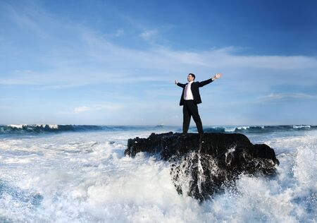 Businessman stranded in the sea
