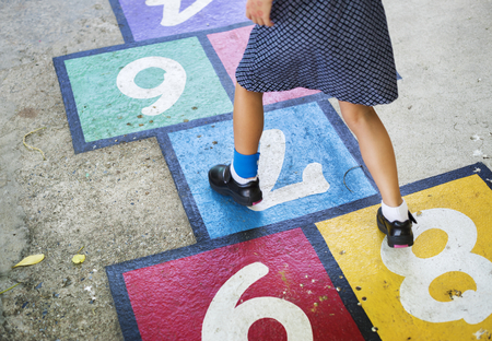 Kid playing hopscotch at school Stock Photo