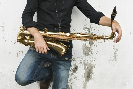 A musician with his saxophone Stockfoto