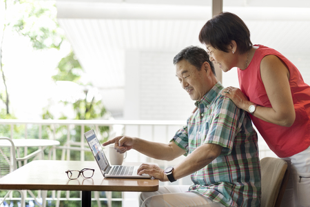 Senior Couple Using Laptop Concept