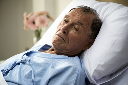 A sick elderly is staying at the hospital Banco de Imagens