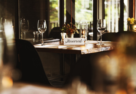 Reserved table at a restaurant Stock Photo