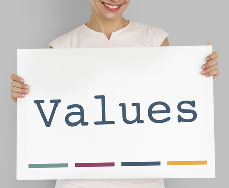 Woman holding a board with Values