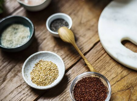 Various cooking seeds on wooden table Imagens