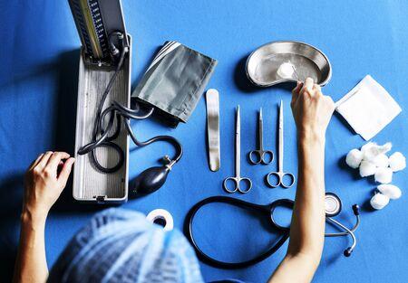 Nurse preparing medical equipment Stock Photo