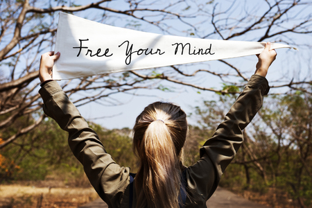 Girl holding free your mind flag banner Stock Photo