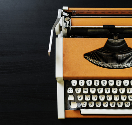 Retro orange typewriter  Reklamní fotografie