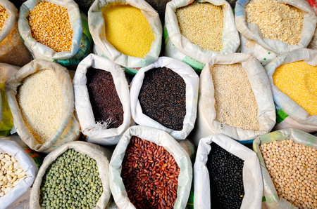 Sacks of healthy legumes and grains. Фото со стока