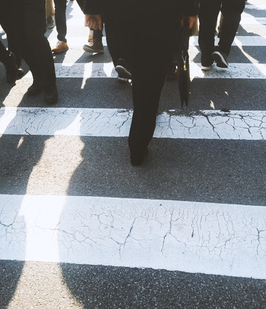 People crossing a street Stock Photo