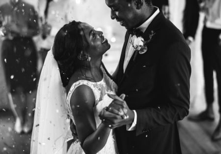 Black couple dancing on their wedding day
