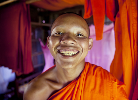 Young smiling Cambodian monk. 版權商用圖片