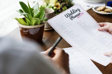 Hands Holding Wedding Planner Checklist Information Preparation Zdjęcie Seryjne - 90760023
