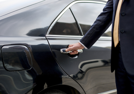 Businessman going inside his car